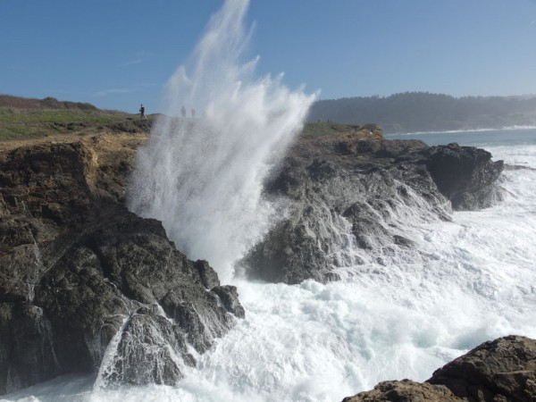 Dramatic waves crash into the headlands